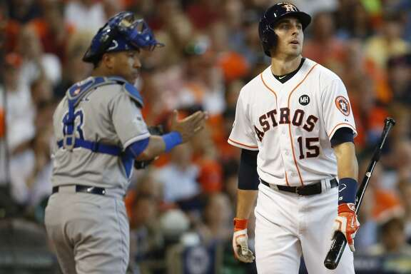 Kansas City Royals catcher Salvador Perez (13) and Houston Astros catcher Jason Castro (15) react to Castro striking out during the second inning of Game 4 of the American League Division Series at Minute Maid Park on Monday, Oct. 12, 2015, in Houston. ( Brett Coomer / Houston Chronicle )