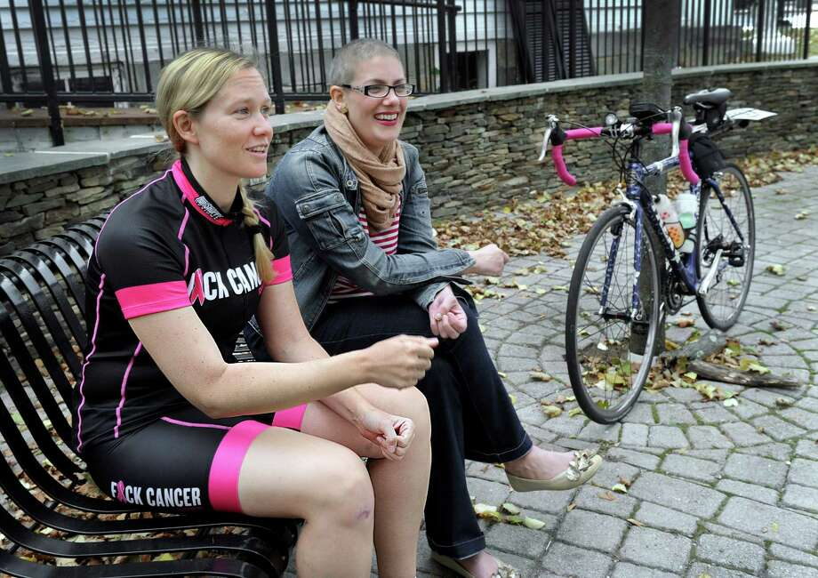Jennifer Lynch, 37, left, is doing a 30-day fundraising bike ride to raise awareness and funds for breast cancer support. Her friend, Ericka Onorato, 38, of New Milford, right, a breast cancer patient, is her motivation. Photo Friday, Oct. 9, 2015. Photo: Carol Kaliff / Hearst Connecticut Media / The News-Times