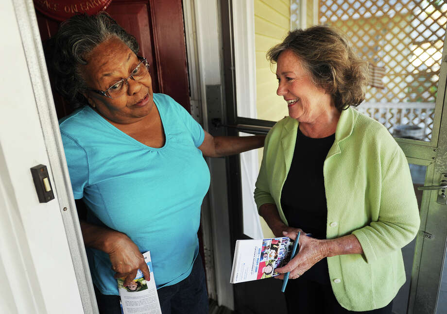Remington Street resident Susie Wilson, left, chats with mayoral candidate Mary-Jane Foster as she campaigns door-to-door in Bridgeport, Conn. on Monday, October 12, 2015. Photo: Brian A. Pounds, Hearst Connecticut Media / Connecticut Post