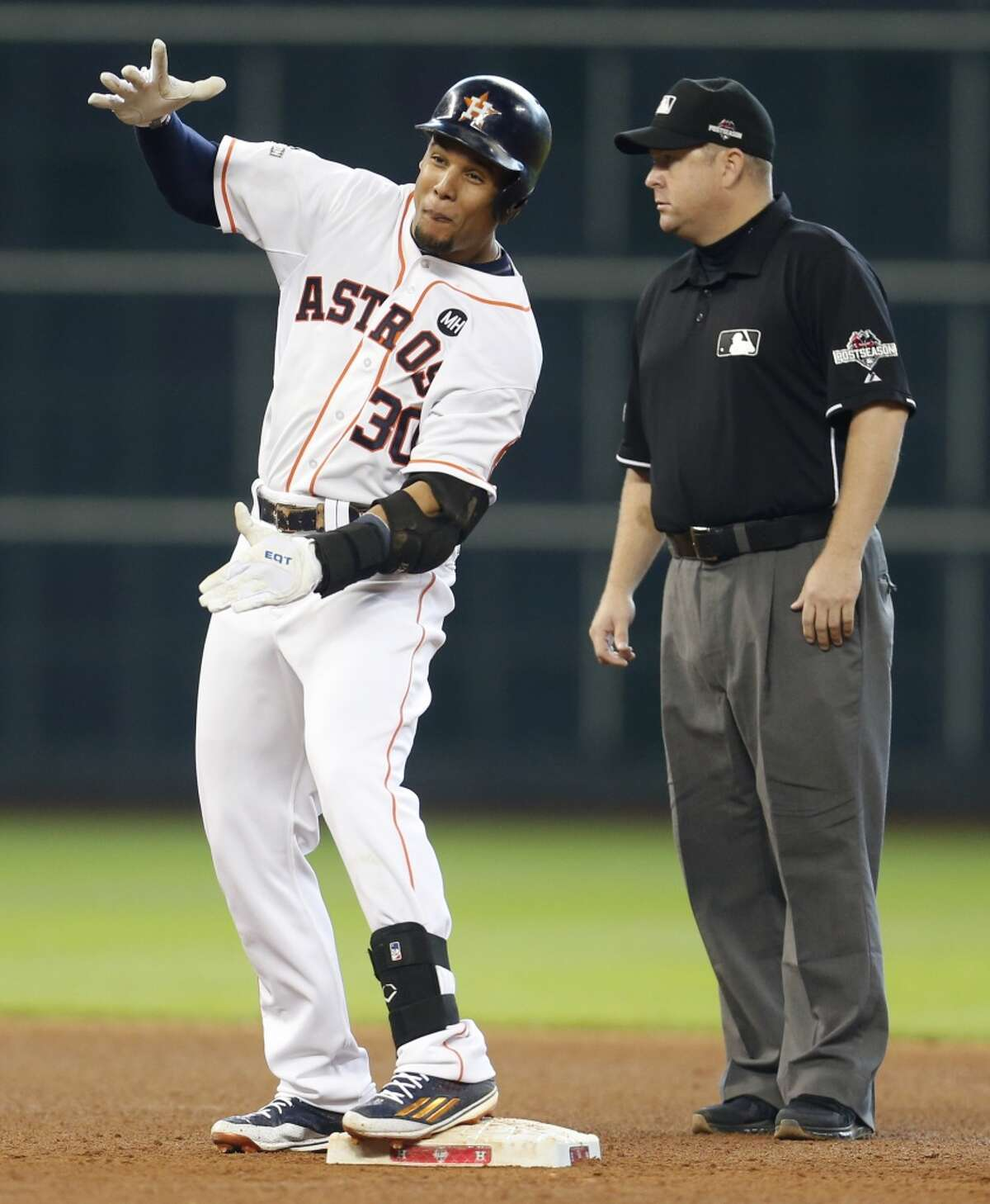 Houston Astros center fielder Carlos Gomez (30) reacts at second base after singling and going to second on a throw during the seventh inning of Game 4 of the American League Division Series against the Kansas City Royals at Minute Maid Park on Monday, Oct. 12, 2015, in Houston. ( Karen Warren / Houston Chronicle )
