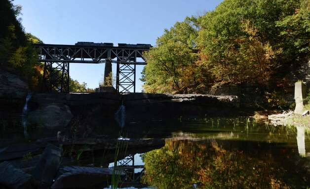 A freight train passes by the Watervliet Reservoir on the Normans Kill at French Mill Rd. Monday afternoon, Oct. 12, 2015, in Guilderland, N.Y. The Capital Region's hazardous materials squad has won a state grant to prepare for a potentially disastrous oil train derailment. But while much of debate about oil train safety locally has focused on the Port of Albany, which has swiftly grown to one of the nation's busiest rail-oil hubs, Albany County Sheriff Craig Apple said he hopes the emergency drill will focus on the potential for a mishap outside the city. (Will Waldron/Times Union) Photo: Will Waldron