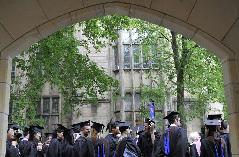 Placing high value on education may be the reason Asian-Americans have fared better than other groups in income and educational attainment. Photo: Jessica Hill /Associated Press / FR125654 AP