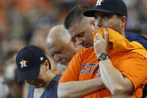 Houston Astros fans watch as the Astros gave up a lead to the Kansas City Royals during the eighth inning of Game 4 of the American League Division Series at Minute Maid Park on Monday, Oct. 12, 2015, in Houston. ( Karen Warren / Houston Chronicle )