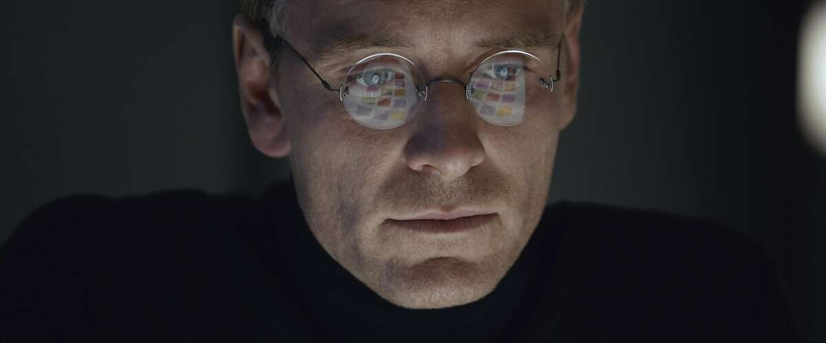 """In this image released by Universal Pictures, Michael Fassbender stars as Steve Jobs in a scene from the film, """"Steve Jobs."""" The movie opens in U.S. theaters on Friday, Oct. 9, 2015. (Universal Pictures via AP)"""