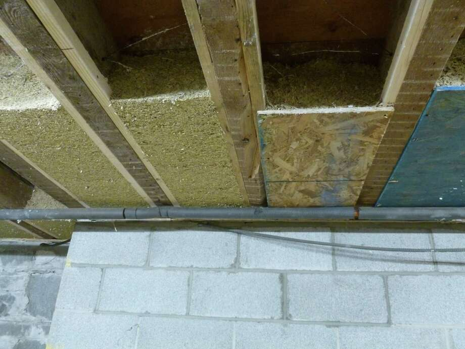 Hempcrete insulation is applied between the joists in Jim Savage's renovated 1850s farmhouse in Stuyvesant, Columbia County.