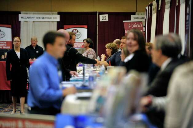 People line up to talk to representatives from various businesses at the Times Union Job Fair on Monday, Oct. 12, 2015, in Colonie, N.Y.     (Paul Buckowski / Times Union) Photo: PAUL BUCKOWSKI / 10033723A