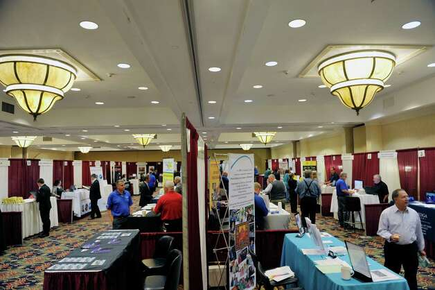 People make their way around to representatives from various businesses at the Times Union Job Fair on Monday, Oct. 12, 2015, in Colonie, N.Y.     (Paul Buckowski / Times Union) Photo: PAUL BUCKOWSKI / 10033723A