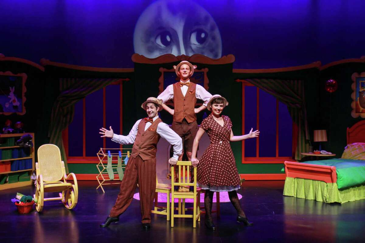 """Cameron William Davis as Papa Bear, from left, Michael Chiavone as Baby Bear, and Sarah Myers as Mama Bear, in this scene from Main Street Youth Theater's production of """"Goodnight Moon."""" (For the Chronicle/Gary Fountain, October 8, 2015)"""