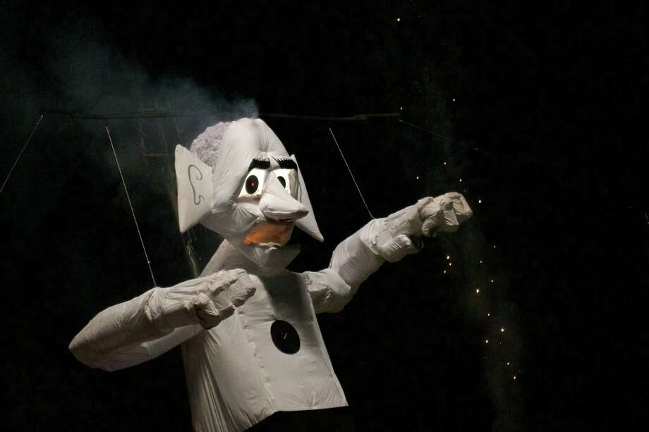 ZozobraThe 50-foot effigy of Old-Man Gloom was created by Will Shuster in 1924. The fire is started inside him by a dancer at his feet.The description fromthe official website:Zozobra is a hideous but harmless fifty-foot bogeyman marionette. He is a toothless, empty-headed facade. He has no guts and doesn't have a leg to stand on. He is full of sound and fury, signifying nothing. He never wins. He moans and groans, rolls his eyes and twists his head. His mouth gapes and chomps. His arms flail about in frustration. Every year we do him in. We string him up and burn him down in ablaze of fireworks. At last, he is gone, taking with him all our troubles for another whole year. Santa Fe celebrates another victory. Viva la Fiesta! – A.W. Denninger Photo: Jay Dryden   jaydrydenphoto.com / copyright 2015 Jay Dryden   jaydrydenphoto.com