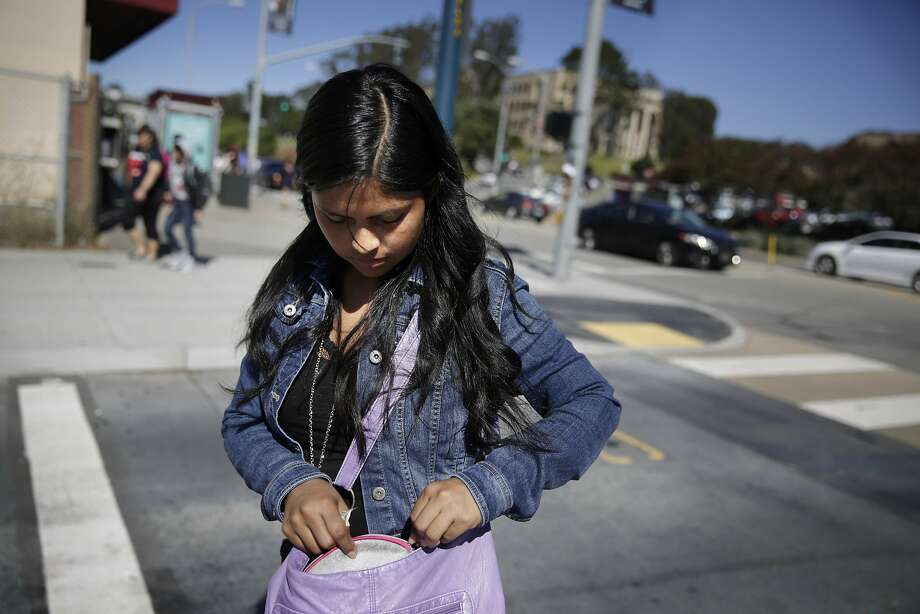 Zuleima Giron, City College of San Francisco student, gathers fare for the bus from her bag after class at City College of San Francisco on Monday, October 12,  2015 in San Francisco, Calif. Photo: Lea Suzuki, The Chronicle