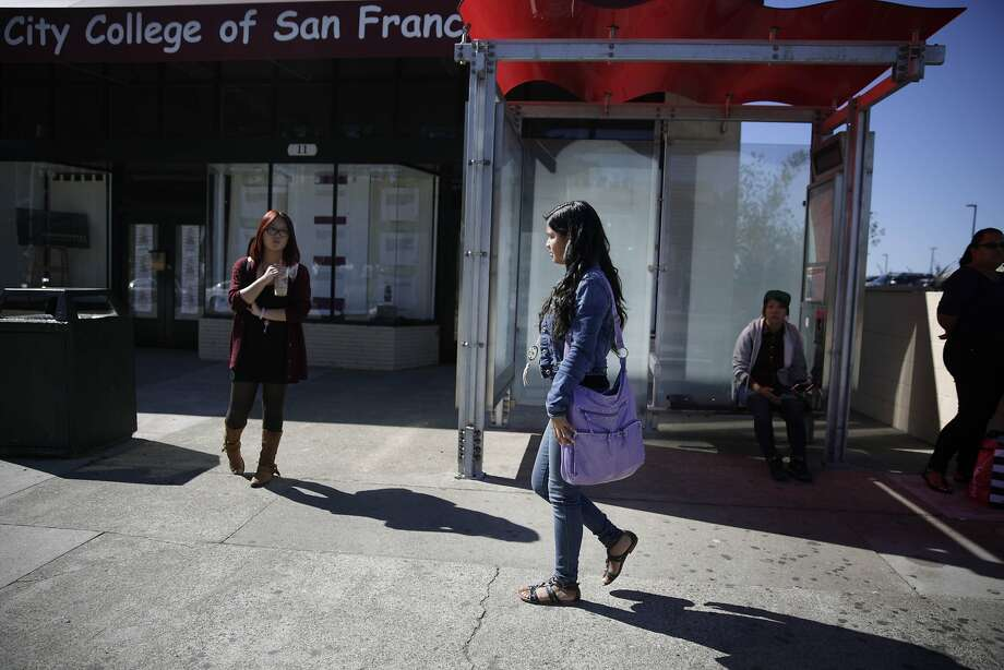 Zuleima Giron, heading for the bus stop after class at City College of San Francisco, wants to become a nursing assistant. Now she can get the diploma from San Francisco International High School that had been out of reach and move toward her career. Photo: Lea Suzuki, The Chronicle