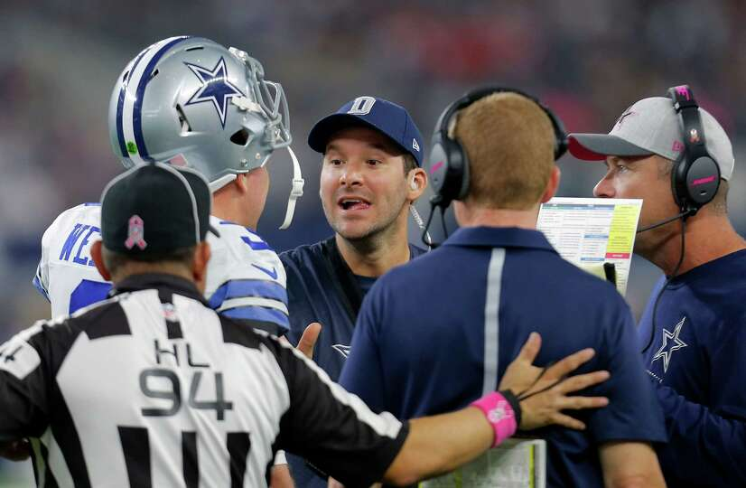 Dallas Cowboys' Tony Rom (center) talks with Brandon Weeden (3) and coaches during the second half