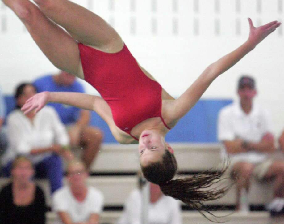 Greenwich's Maddie Muldoon competes in the diving event of a girls varsity swim meet against Wilton in Greenwich, Conn. on Oct.12, 2015. Muldoon won the event with a score of 253.75. Photo: Matthew Brown, For Hearst Connecticut Media / Connecticut Post Freelance