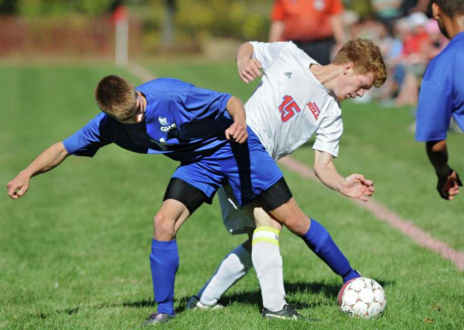 Galway's Conor Bradshaw, left, and Maple Hill's Reny Hoffman battle for the ball during a soccer game on Monday, Oct. 12, 2015 in Castleton, N.Y. (Lori Van Buren / Times Union) Photo: Lori Van Buren / 10033718A
