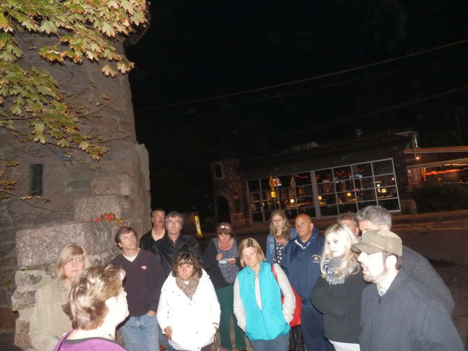 Local author Cindy Boynton leads a Milford Ghost Walk downtown. Photo: Provided Photo / Cindy Boynton