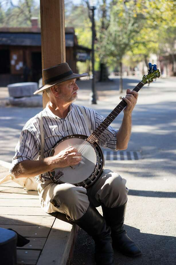 Rick Walters plays the banjo at Columbia State Park in Columbia, Calif. on Friday, Oct. 9, 2015. Columbia has the largest number of gold rush-era buildings. Photo: James Tensuan