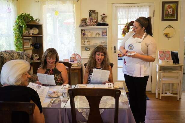 Destinee Kennedy, right, writes down tea orders for (left to right) Lorraine Witzel, Pam King and Suzie King at Dori's Tea Cottage in Groveland, Calif. on Saturday, Oct. 10, 2015. Co-owners Dori and Greg Jones pay tribute to Dori's english grandmother by serving tea in bone china cups.