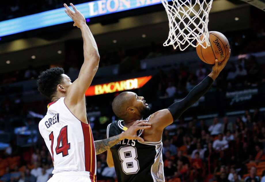 San Antonio Spurs guard Patty Mills (8) goes up to shoot against Miami Heat guard Gerald Green (14) during the first half of a preseason NBA basketball game, Monday, Oct. 12, 2015, in Miami. (AP Photo/Wilfredo Lee) Photo: Wilfredo Lee, Associated Press / AP
