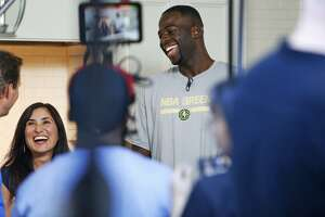 Draymond Green tips off Warriors' 'Go Green' platform - Photo