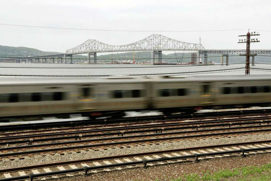 File - A Metro North train streaks along the Hudson River just south of the Tappan Zee Bridge, Tuesday, May 13, 2014, in Tarrytown, N.Y. (AP Photo/Julie Jacobson) Photo: Julie Jacobson / AP