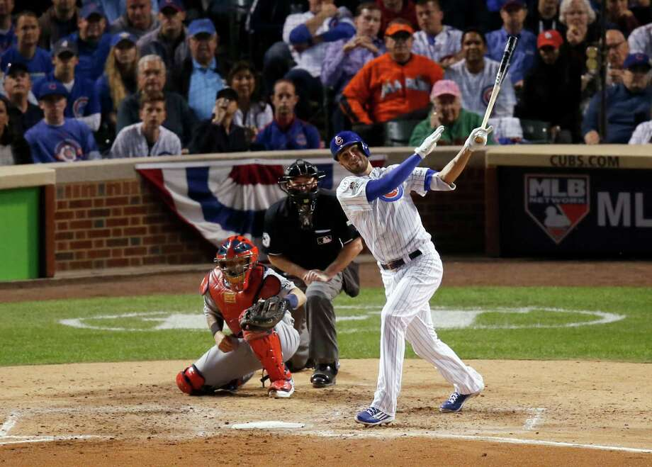 Chicago Cubs third baseman Kris Bryant (17) hits a two-run home run against the St. Louis Cardinals during the fifth inning of Game 3 in baseball's National League Division Series, Monday, Oct. 12, 2015, in Chicago. (AP Photo/Charles Rex Arbogast) ORG XMIT: CXC138 Photo: Charles Rex Arbogast / AP