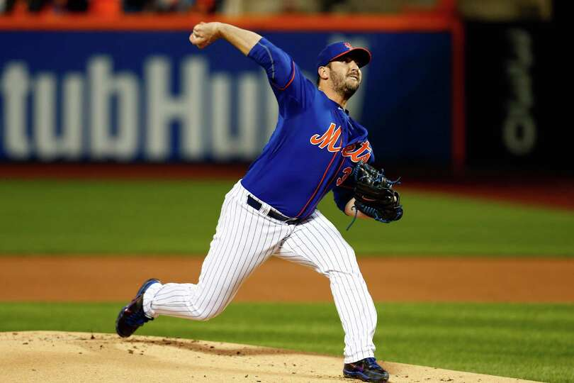 NEW YORK, NY - OCTOBER 12:  Matt Harvey #33 of the New York Mets throws a pitch in the first inning