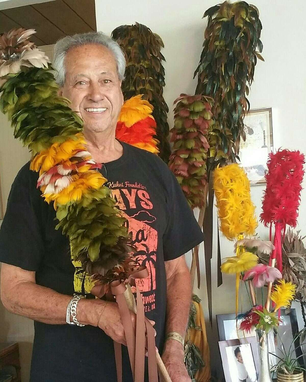 Herman Tachera and his kahili (feather staffs).