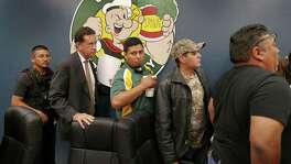 A police officer, at left, escorts Crystal City attorney James Jonas, councilman Marco Rodriguez, Mayor Ricardo Lopez and councilman Joel Barajas from a meeting at which many citizens expressed anger at the council's proposed tax hike and attorney Jonas' high salary on Friday, Oct. 9, 2015.