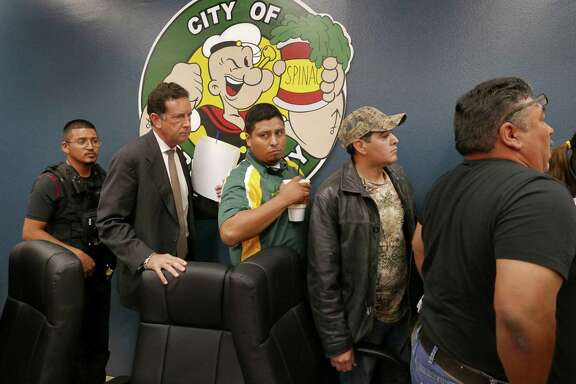 A police officer (from left) escorts City Manager James Jonas III, Councilman Marco Rodriguez, Mayor Ricardo Lopez and Councilman Joel Barajas from a meeting in Crystal City last year. Jonas, Rodriguez and Lopez are facing criminal charges.
