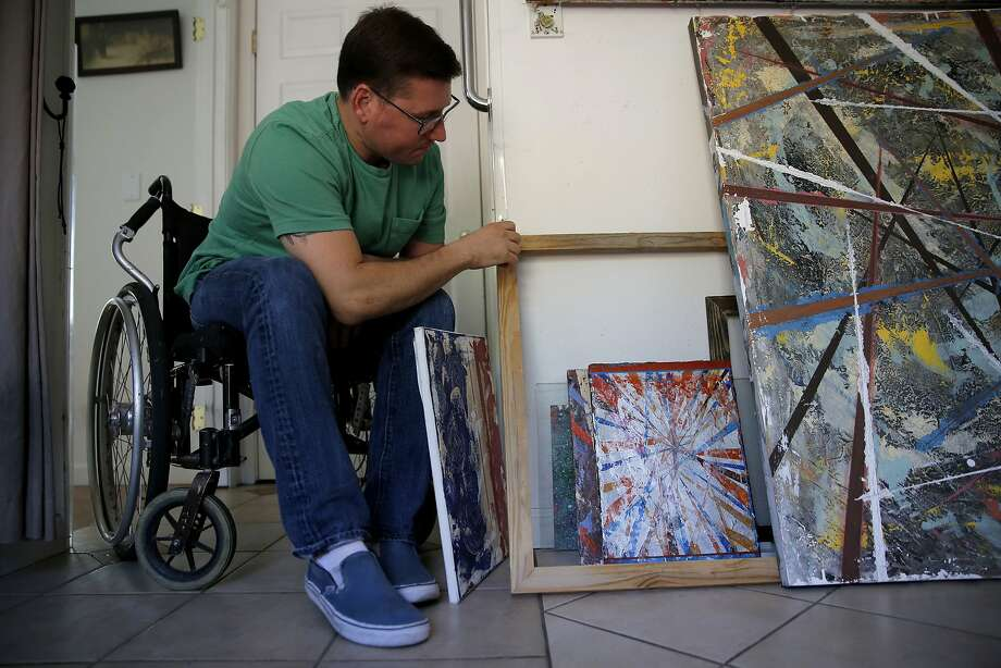 Tim Strouss looks through paintings and frames he created at his home in San Jose, California, on Monday, Oct. 12, 2015. Photo: Connor Radnovich, The Chronicle