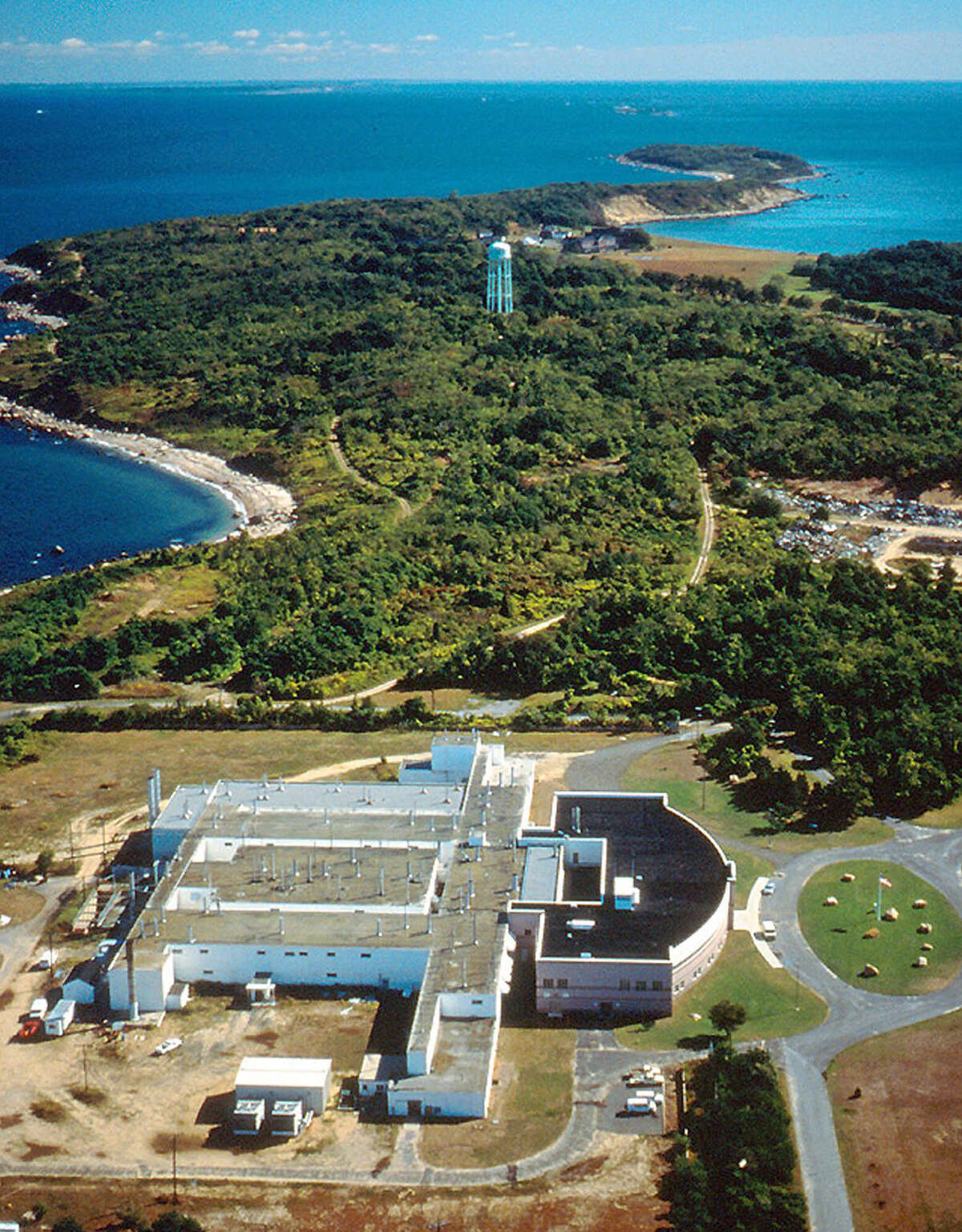 In this undated photo provided by the Agricultural Research Service of the Department of Agriculture, Plum Island Animal Disease Center, off the coast of New York?'s Long Island, is shown. The future of the mysterious island where infectious animal diseases have been studied since the 1950s is about to gain renewed focus. One federal agency is preparing a final report on Plum Island's proposed sale at the same time Long Island officials consider new zoning laws that will prevent any significant development of the 843-acre property should it be sold. (AP Photo/ARS-USDA)
