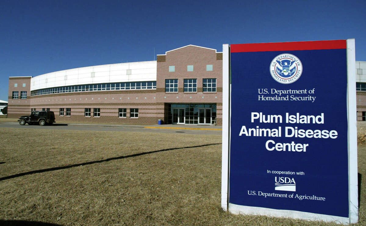 In this Feb. 16, 2004 file photo, a security patrol jeep is parked in front of the Plum Island Animal Disease Center on Plum Island off of the east coast of New York's Long Island. Congress voted in 2009 to close the aging lab and move operations to Kansas State University.