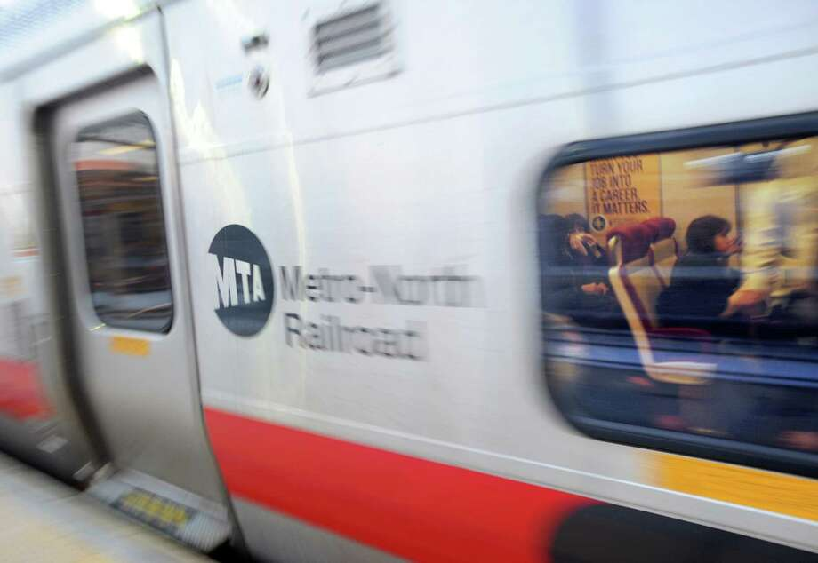 Passengers on board a Metro-North train at the Stamford Train Station, Conn. The railroad is reporting delays in and out of Grand Central Termonal because of signal problems. Photo: Bob Luckey / Bob Luckey / Greenwich Time