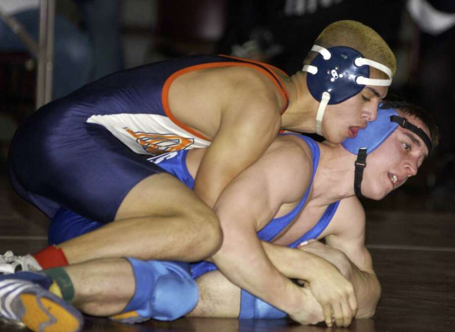 Anthony Hayes  of Danbury High defeats Bill St. Pierre of Southington Saturday Feb. 16, 2002, in Bristol. (Photo Douglas Healey). Photo: File Photo / File Photo / The News-Times File Photo