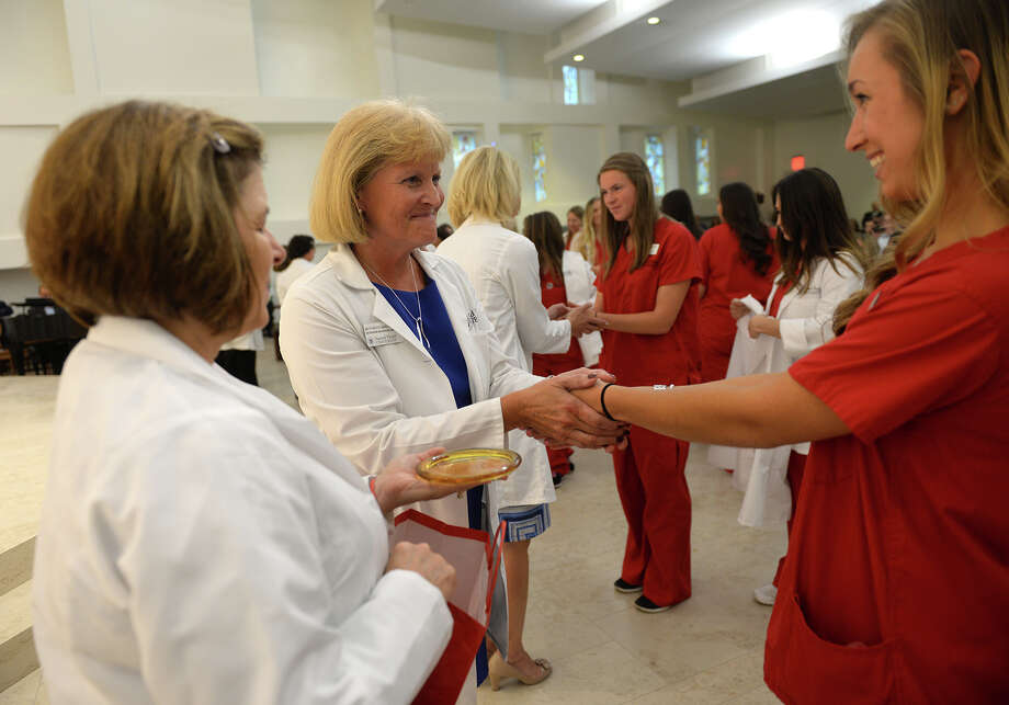 Sacred Heart University Director of Nursing Simulation & Clinical Laboratories Beth Boyd, center, blesses the hands of nursing student Jenna Greco, right, at the Chapel of the Holy Spirit on October 2, 2015. Also participating, at left, is Anne Marie Adiletta. Photo by Tracy Deer-Mirek Sacred Heart University Director of Nursing Simulation & Clinical Laboratories Beth Boyd, center, blesses the hands of nursing student Jenna Greco, right, at the Chapel of the Holy Spirit on October 2, 2015. Also participating, at left, is Anne Marie Adiletta. Photo by Tracy Deer-Mirek Photo: Contributed / Contributed / Connecticut Post