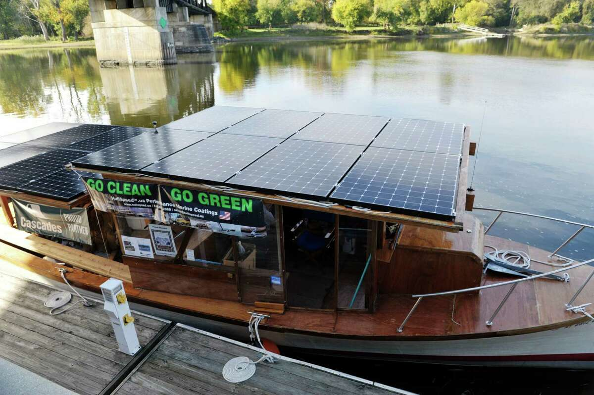 A view of the boat Solar Sal, at the Waterford Harbor Front on Tuesday, Oct. 13, 2015, in Waterford, N.Y. Solar Sal, began the first ever cargo delivery in the history of the Erie Canal done entirely without fossil fuels in Lockport on September 29th. The boat is powered solar panels. Solar Sal is carrying four tons of cardboard for recycling bound for Cascades?' Mechanicville plant. The boat made a stop in Waterford before heading up to Mechanicville for its final stop and to deliver the cargo. (Paul Buckowski / Times Union)