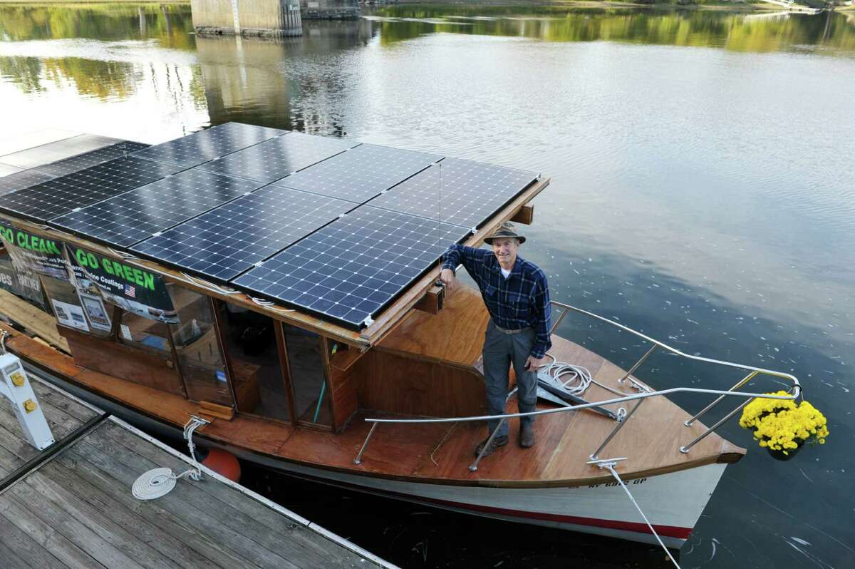 David Borton, captain of the boat Solar Sal, stands on his baot at the Waterford Harbor Front on Tuesday, Oct. 13, 2015, in Waterford, N.Y. Solar Sal, began the first ever cargo delivery in the history of the Erie Canal done entirely without fossil fuels in Lockport on September 29th. The boat is powered solar panels. Solar Sal is carrying four tons of cardboard for recycling bound for Cascades' Mechanicville plant. The boat made a stop in Waterford before heading up to Mechanicville for its final stop and to deliver the cargo. (Paul Buckowski / Times Union)