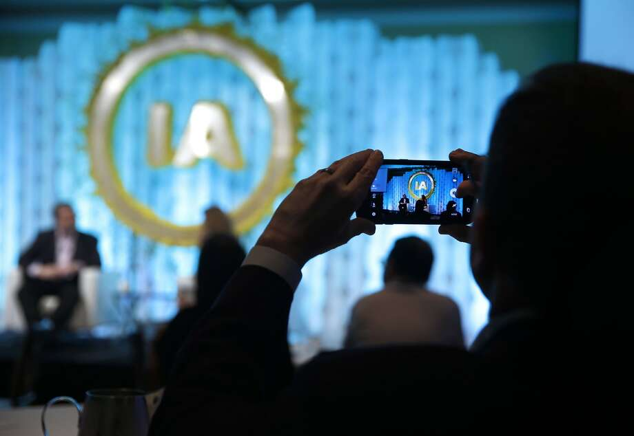 A conference attendee snaps a photo of the stage during a fireside chat between LinkedIn executive chairman and co-founder Reid Hoffman and CNBC's Julia Boorstin at the Internet Association's Virtuous Circle conference in Menlo Park, Calif. on Tuesday, Oct. 13, 2015. Photo: Paul Chinn, The Chronicle