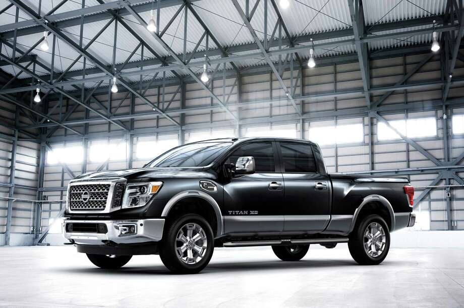 The 2016 Nissan TITAN XD, which made its world debut at the 2015 North American International Auto Show in Detroit, is set to shake up the highly competitive full-size pickup segment when it goes on sale in the United States and Canada beginning in late 2015 - with a bold all-new design that stakes out a unique position in the segment between traditional heavy-duty and light-duty entries. Photo: Nissan / © 2015 Nissan