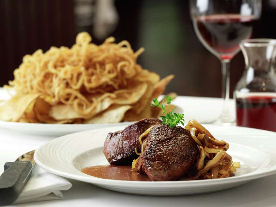 The Palm Houston Restaurant, 6100 Westheimer, has started a new three-course ìpower lunchî menu that includes a starter, entrée (with individual side) and dessert for $25.90. Shown: Filet mignon medallions. Photo: The Palm Houston Restaurant / (C)Renee Comet