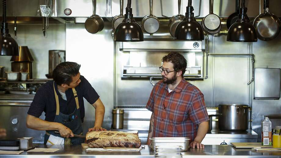 Chef de cuisine Rex Huang and executive chef Matthew Lightner discuss the night's menu at Ninebark in Napa. Photo: Russell Yip, The Chronicle