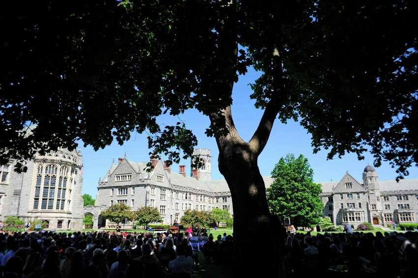 Students, faculty, graduates, family and friends gather on the lawn for the 200th commencement for the Emma Willard School on Sunday, May 25, 2014, in Troy, N.Y. (Paul Buckowski / Times Union archive)
