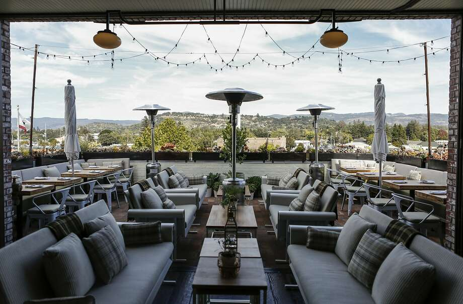 Outdoor seating on the third floor of Ninebar overlooks Napa's downtown area. Photo: Russell Yip, The Chronicle