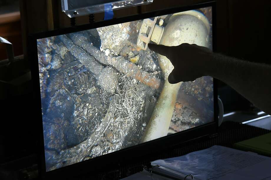 NOAA marine heritage regional coordinator Robert Schwemmer points to a live video feed of the wreckage of the Ituna in the waters of the Greater Farallones National Marine Sanctuary off of Point Reyes in October. Photo: Michael Short, Special To The Chronicle