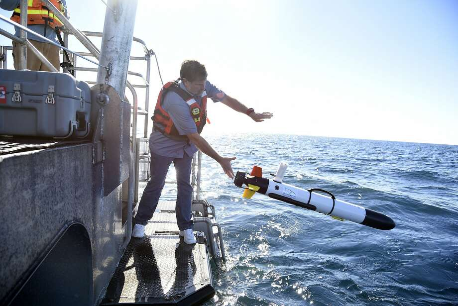 NOAA Marine Heritage Regional Coordinator Robert Schwemmer launches the Iver 2 that will dive and sonar scan the wreckage of second newly discovered unnamed sunken fishing trawler in the waters of the Greater Farallones National Marine Sanctuary off Point Reyes in October.  Photo: Michael Short, Special To The Chronicle