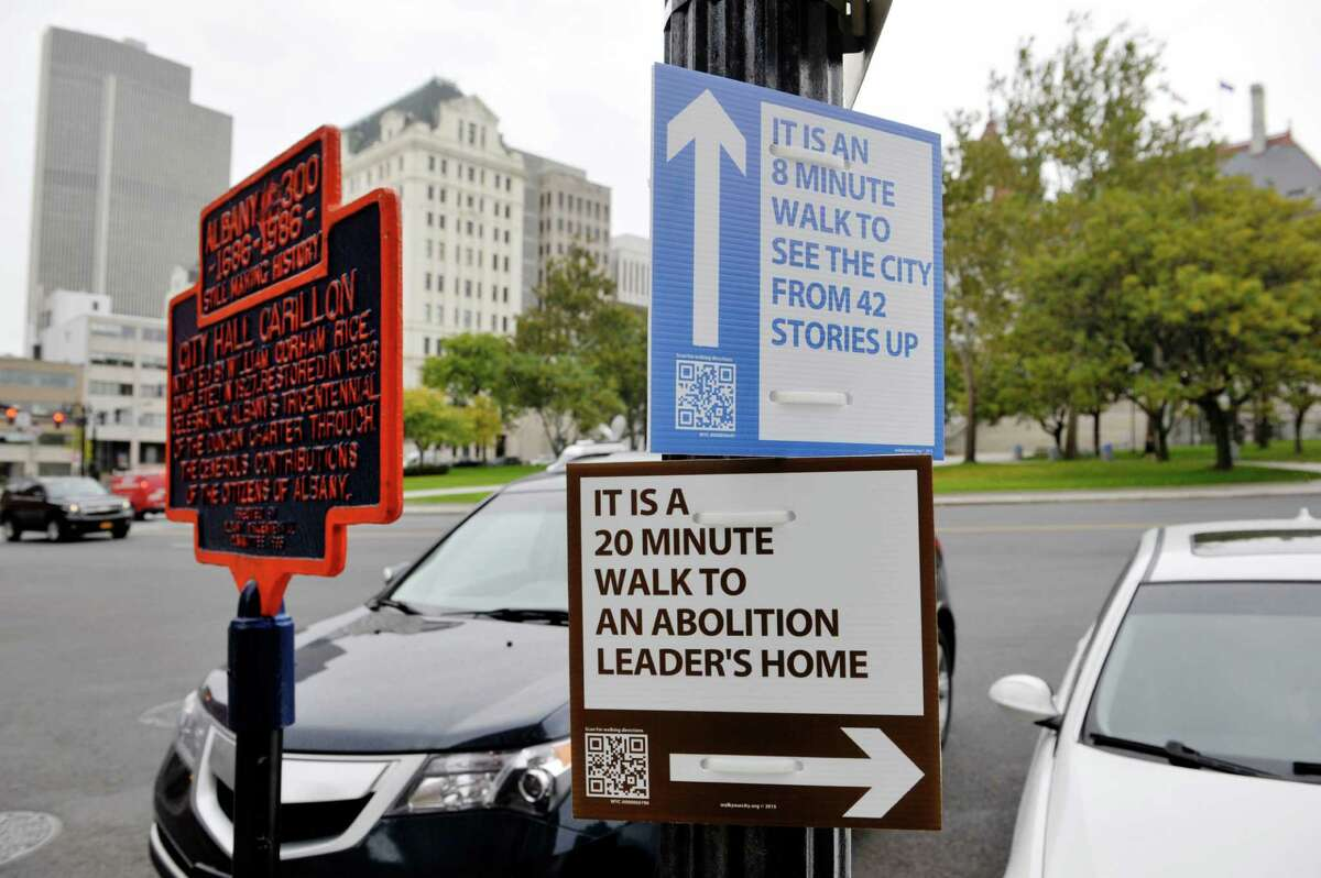 A view of some of the Walk Your City signs up in Albany, seen on Tuesday, Oct. 13, 2015, in Albany, N.Y. Albany Mayor Kathy Sheehan held a press conference on Tuesday to unveil 100 new Walk Your City signs. The signs have QR codes and when a person uses a QR reader on their smartphone they get taken to a website with walking directions from their location, a live Google map with other attractions listed on the map, and they get an information tab about the location they are going to. (Paul Buckowski / Times Union)
