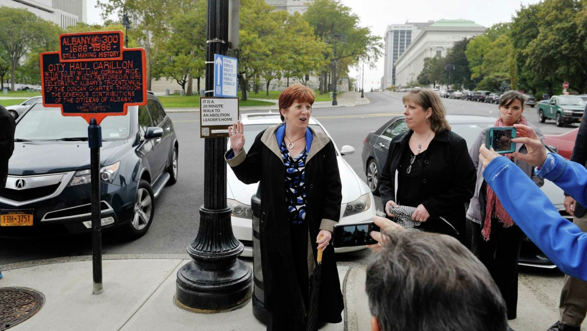 Albany Mayor Kathy Sheehan talks about the new Walk Your City Signs at a press conference on Tuesday, Oct. 13, 2015, in Albany, N.Y. The signs have QR codes and when a person uses a QR reader on their smartphone they get taken to a website with walking directions from their location, a live Google map with other attractions listed on the map, and they get an information tab about the location they are going to. (Paul Buckowski / Times Union)