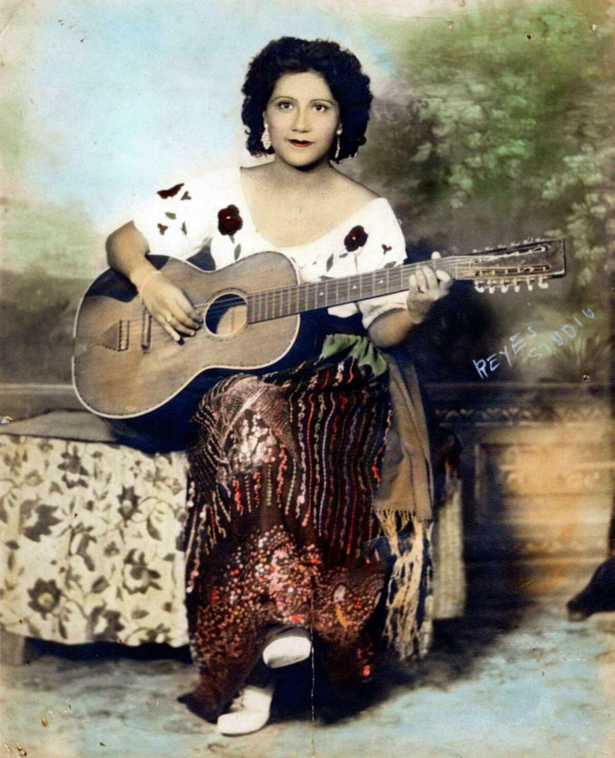 Undated photograph of ranchera singer Celia Mireles. The San Antonio singer was a contemporary of Lydia Mendoza. Mireles wrote and recorded her own songs in the mid-1930s and also performed with Mendoza. Her sister made the dress she is wearing.