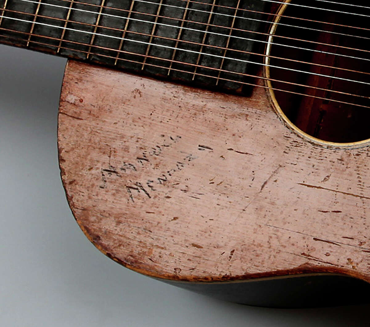 A name - Manuel Mendoza - is carved into the top of Mireles' guitar. Manuel Mendoza was singer Lydia Mendoza's brother, who was also a musician.