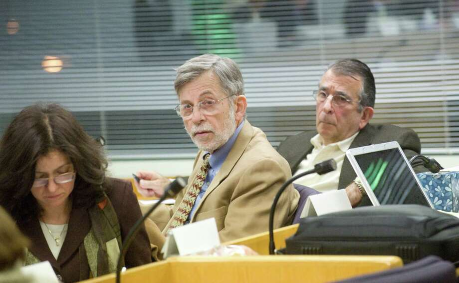 The Board of Ethics investigating panel members Cheryl Bader, Allan Lang and Sheldon Levine listen during a 2011 hearing. City Rep. J.R. McMullen has asked for advice on when representatives should disclose possible conflicts of interest. Photo: Keelin Daly / ST / Stamford Advocate